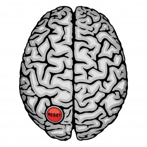 Human brain with Reset button.